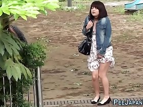 Urinating asians watched